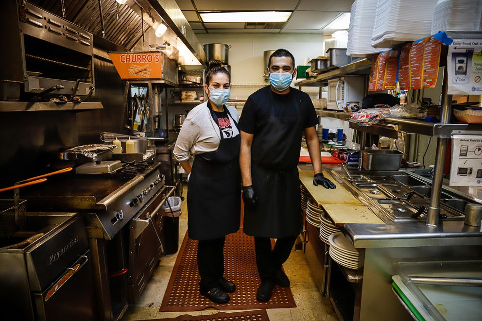 Elisa Yepez Oregel and her husband Manuel Tafoya Ramos juggle their kids' virtual classes, language barriers, and operating their family's restaurant Pedro's Mexican Grill. Photographed October 2020. (Photo by Jeff Chen / Alaska Public Media)