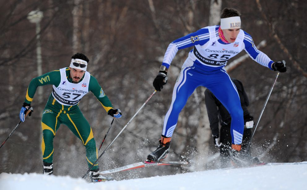 Lutz Klausmann of UAA, left, chases Tyler Kornfield of UAF up a hill in a 2012 college race at Kincaid Park. (Erik Hill / Anchorage Daily News)