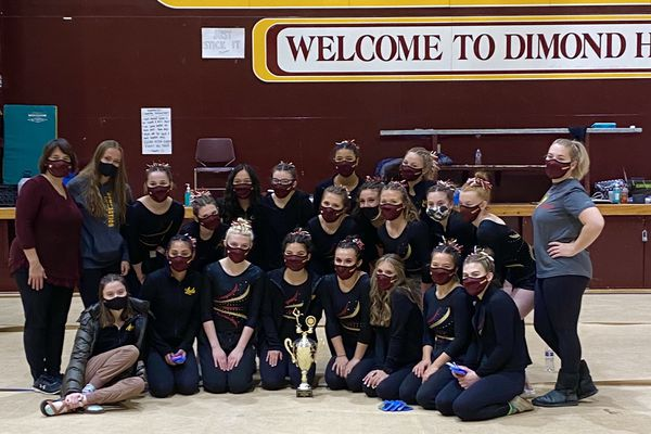 Dimond High gymnasts pose with their trophy after winning the Cook Inlet Conference meet Saturday, November 7, 2020, at Dimond High (Photo courtesy Dimond High gymnastics.)