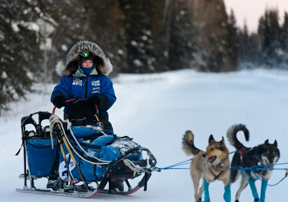 Paige Drobny and her team pull away from the Central checkpoint during the Yukon Quest International Sled Dog Race on Feb. 10. (Marc Lester / ADN)