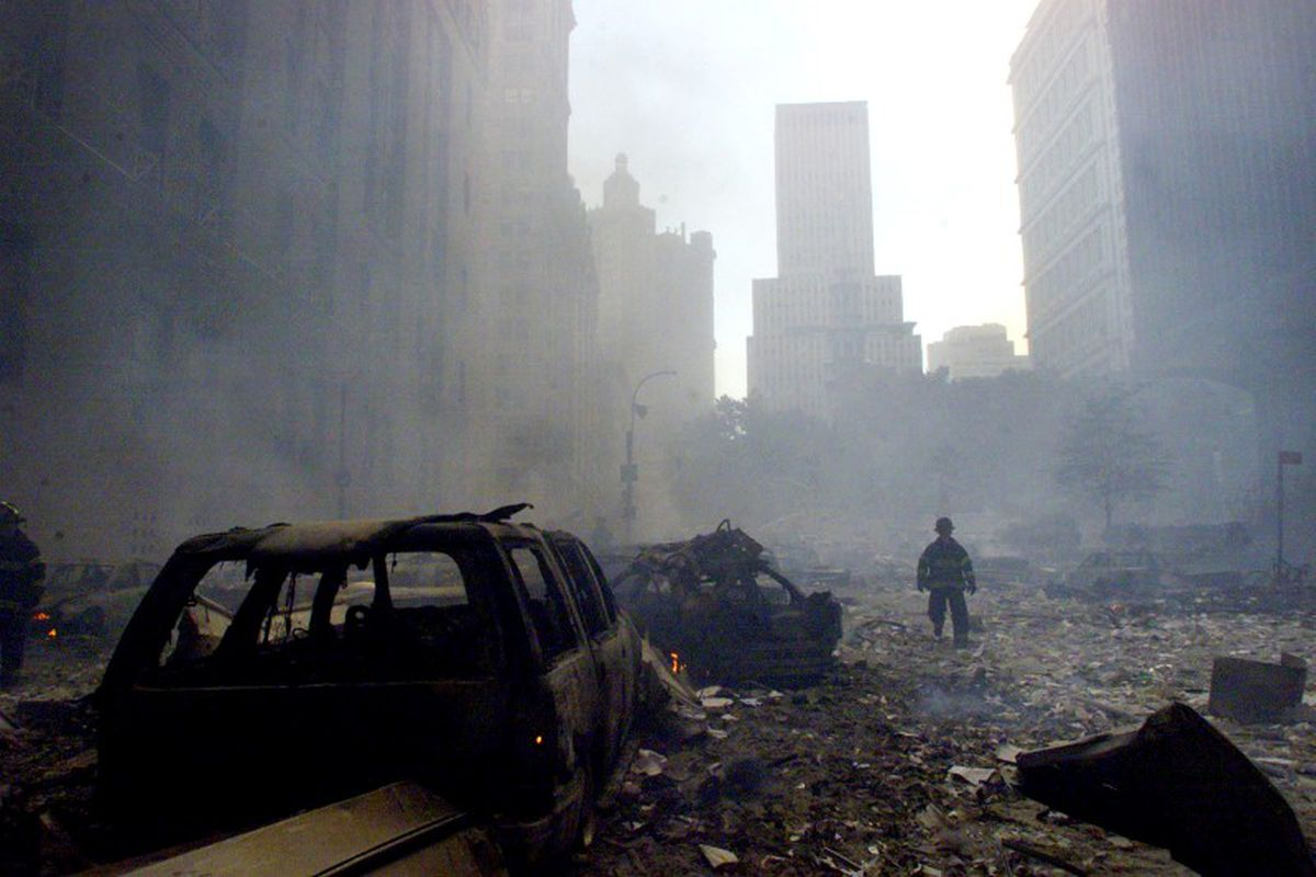 A firefighter walks amid rubble near the base of the destroyed World Trade Center in New York on Sept. 11, 2001. (Peter Morgan / Reuters file)