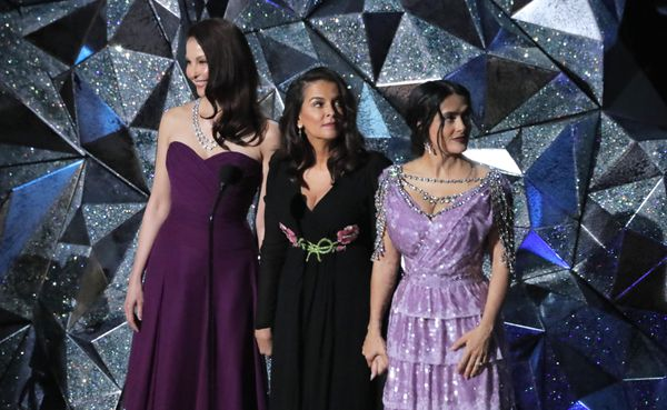 Ashley Judd, Annabella Sciorra and Salma Hayek hold hands as they watch a video about diversity during the Oscars show. REUTERS/Lucas Jackson