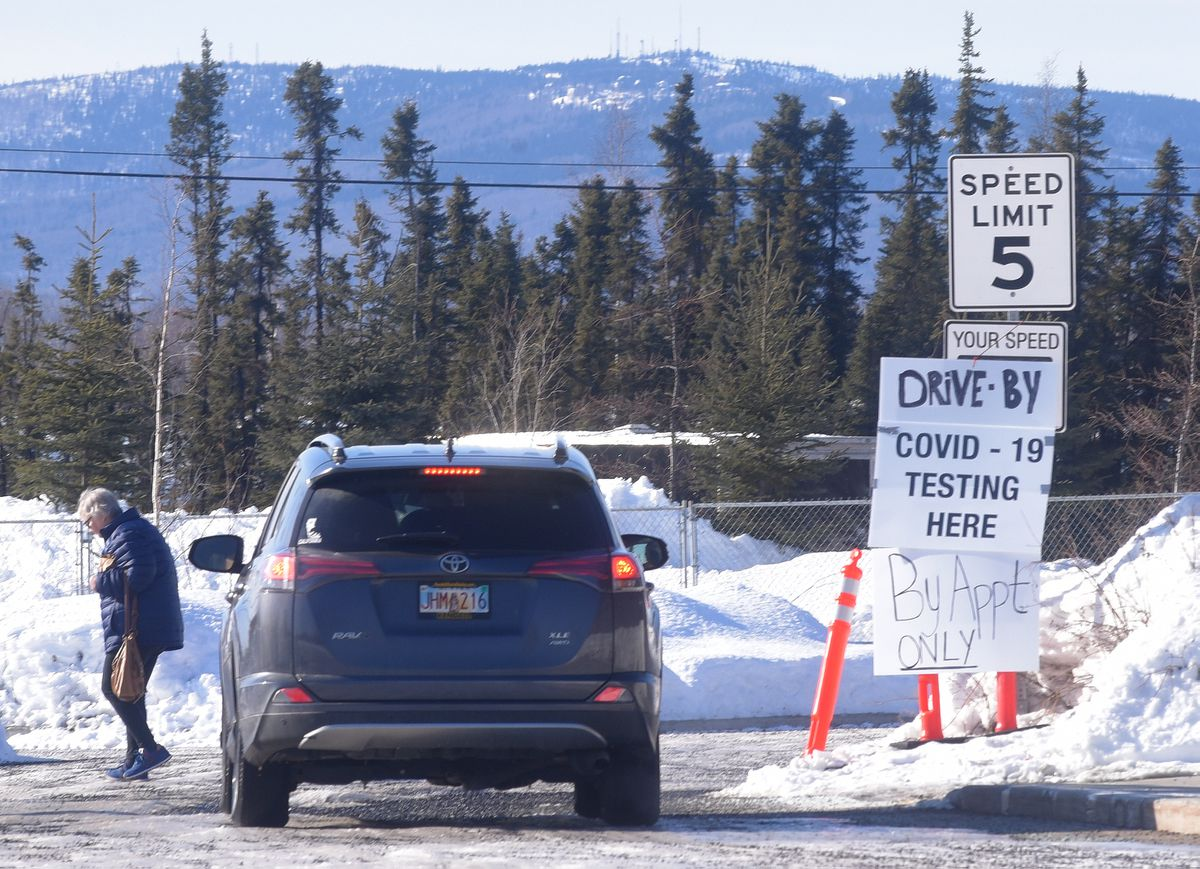 A sign directing patients to drive-by COVID-19 testing in the parking lot of the Chief Andrew Isaac Health Center in Fairbanks on March 31, 2020. (Photo by Eric Engman)