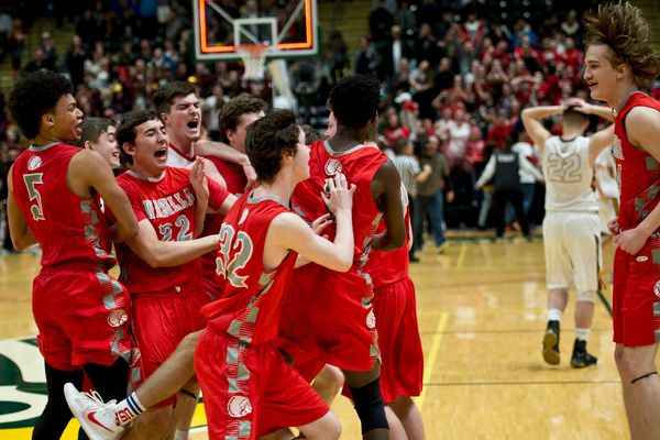 Wasilla celebrates their title. Wasilla beat Dimond, 47-44, in the boys basketball 4A state championship on March 24, 2018. (Marc Lester / ADN)