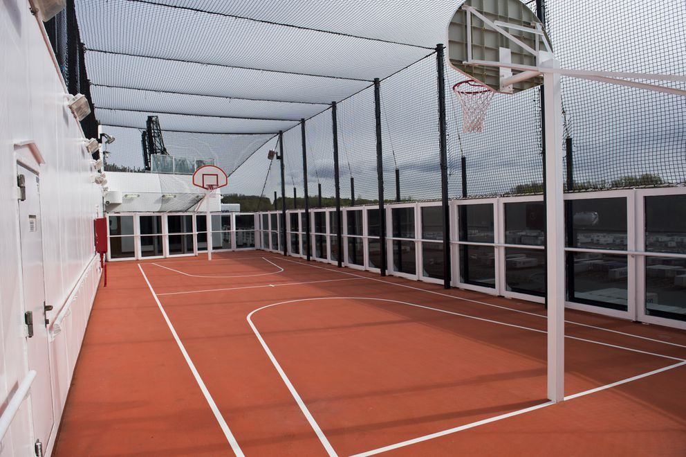 A basketball court is covered in netting on a Zaandam deck. (Marc Lester / ADN)