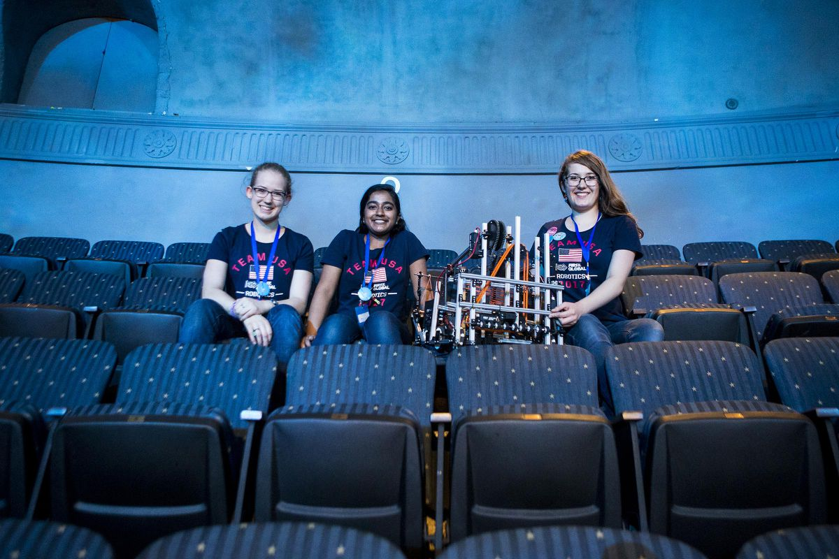 From left, Katie Johnson, Sanjna Ravichandar and Colleen Johnson sit with their robot while watching the FIRST Global competition at DAR Constitution Hall. (Photo for The Washington Post by April Greer)