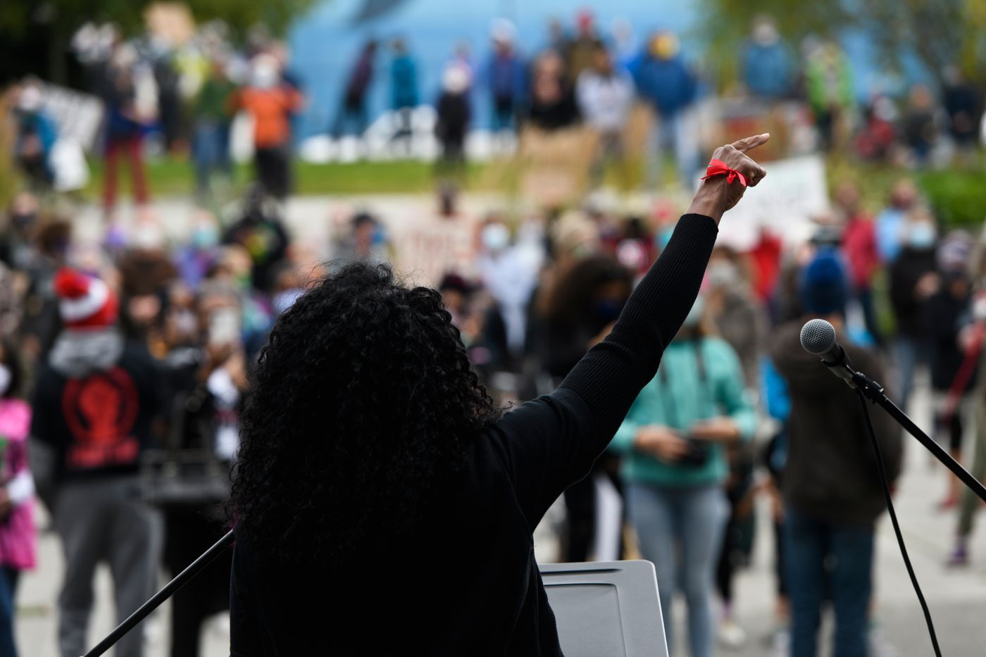 Celeste Hodge Growden, president of Alaska Black Caucus, speaks at the audience at Town Square at the start of the March on Alaska event. (Marc Lester / ADN)