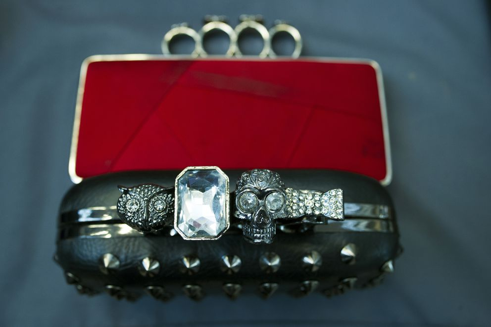Items, prohibited on passenger airlines, and confiscated from passengers by Transportation Security Administration (TSA) officers, is displayed at Dulles International Airport in Dulles, Va., Tuesday, March 26, 2019. The items include three cluch purses with brass knuckle handles. TSA's social media presence has been something of a model for other federal agencies _ striking a tone is humorous, but still gives travelers informational dos and don'ts. (AP Photo/Cliff Owen)