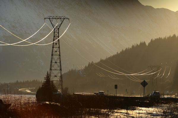 Power lines are highlighted by the setting sun along Turnagain Arm and the Seward Highway south of Anchorage, Alaska on Sunday, March 26, 2017. (Bob Hallinen photo)