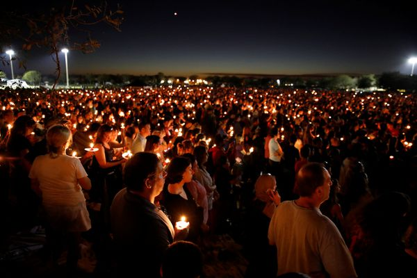 People attend a candlelight vigil for victims of the shooting at nearby Marjory Stoneman Douglas High School, in Parkland, Florida, February 15, 2018. REUTERS/Carlos Garcia Rawlins