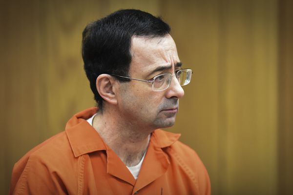 FILE - In this Feb. 5, 2018, file photo, Larry Nassar, former sports doctor who admitted molesting some of the nation's top gymnasts, appears in Eaton County Court in Charlotte, Mich. In a statement late Wednesday, Oct. 17, 2018, the Walker County district attorney's office in Huntsville, Texas, said that former USA Gymnastics president Steve Penny has been arrested after a Texas grand jury indicted him, alleging he tampered with evidence in the sexual assault investigation of now-imprisoned gymnastics doctor Larry Nassar. Penny now awaits extradition to Texas. (Matthew Dae Smith/Lansing State Journal via AP, File)