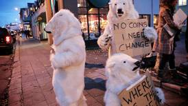 Greenpeace protests at Arctic conference, decrying Russia's detention of activists