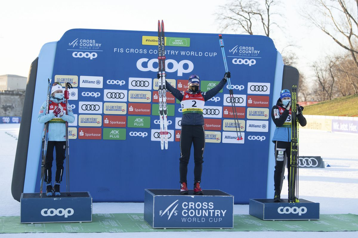 Sophie Caldwell Hamilton from USA, Nadine Faehndrich from Switzerland and Anamarija Lampic from Slovenia, from left, stand next to each other during the award ceremony of the cross country skiing World Cup in Dresden, Germany, Saturday, Dec. 19, 2020. (Sebastian Kahnert/dpa via AP)