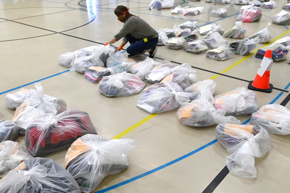Special education teacher assistant Anita Thiele organizes student personal belongings in Sand Lake Elementary on Tuesday, May 5, 2020, during the COVID-19 pandemic. (Bill Roth / ADN)