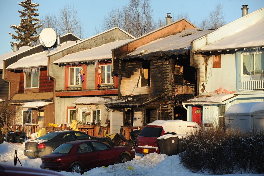 3 people died in an early morning townhouse fire at 115 E 17th Avenue in Anchorage, AK on Friday, Feb. 23, 2018. (Bob Hallinen / ADN)