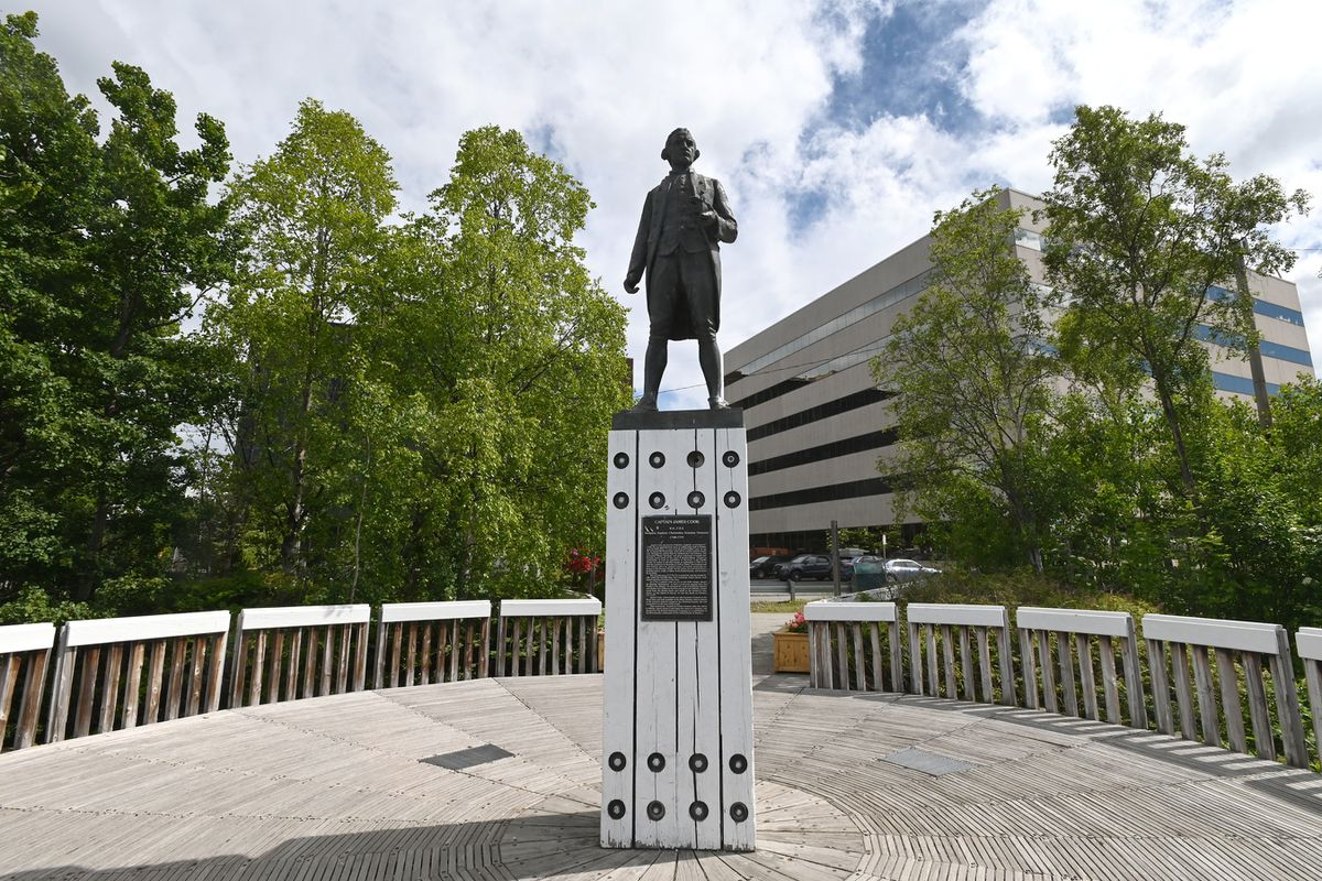 A statue of Captain James Cook stands on a plinth in Resolution Park overlooking the Cook Inlet near 3rd Avenue in Anchorage on Wednesday, June 17, 2020. (Bill Roth / ADN)