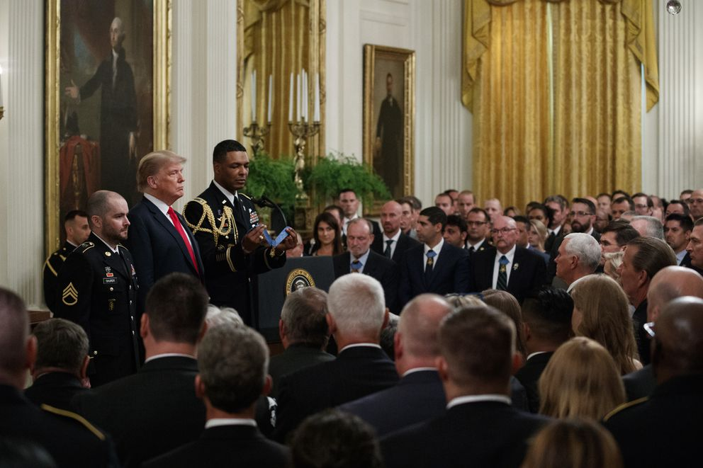President Donald Trump stands with former Army Staff Sgt. Ronald J. Shurer II before presenting him with the Congressional Medal of Honor for actions in Afghanistan, in the East Room of the White House, Monday, Oct. 1, 2018, in Washington. (AP Photo/Evan Vucci)