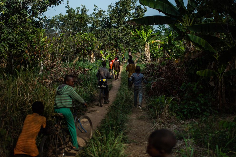 Children leave the cocoa farm at the end of the workday. (Washington Post photo by Salwan Georges)
