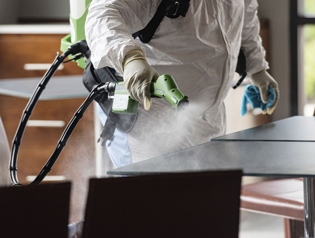 FILE - In this July 2, 2020 file photo, a service technician wears a protective suit while using an electrostatic gun to clean a surface area during the coronavirus pandemic in Tyler, Texas. (Sarah A. Miller/Tyler Morning Telegraph via AP, File)