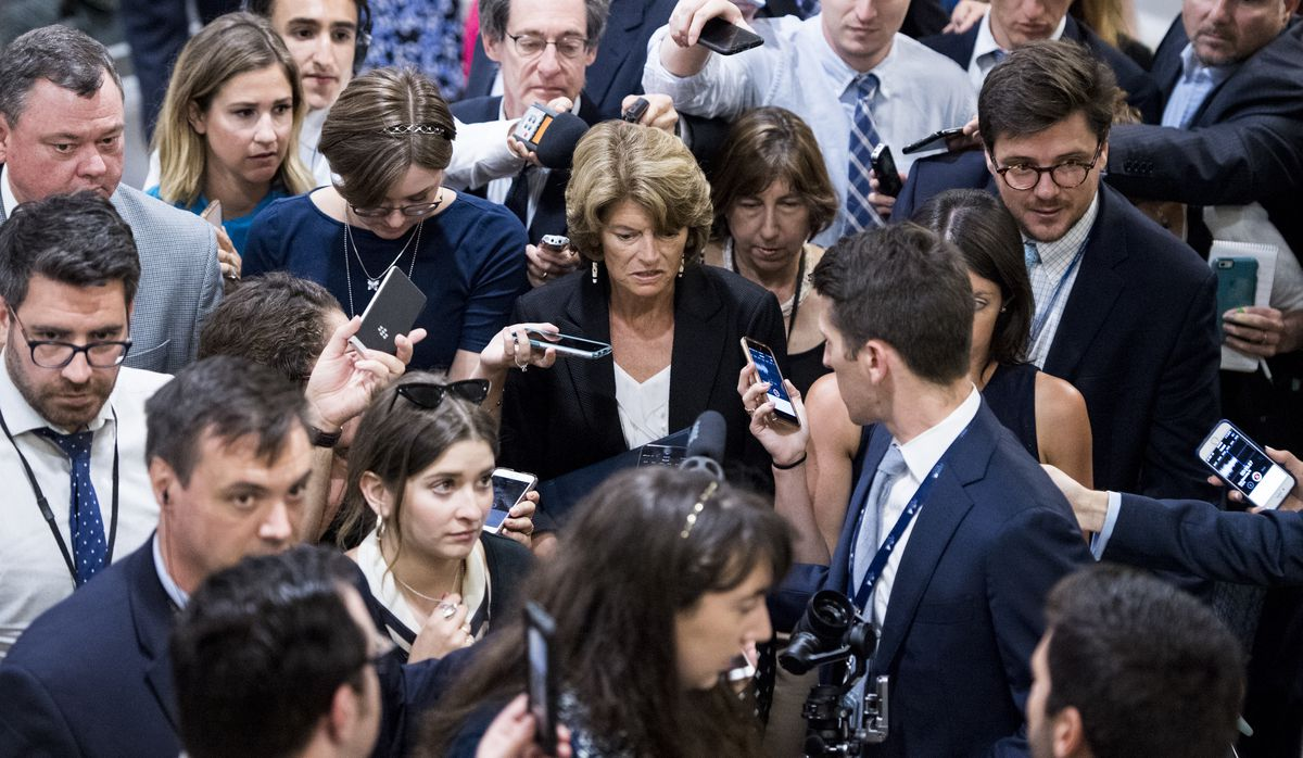 Reporters swarm Sen. Lisa Murkowski, R-Alaska, as she arrives for the Senate Republicans' policy lunch in the Capitol on Tuesday, the day after President Donald Trump nominated Brett Kavanaugh to the Supreme Court. (CQ Roll Call via AP Images)
