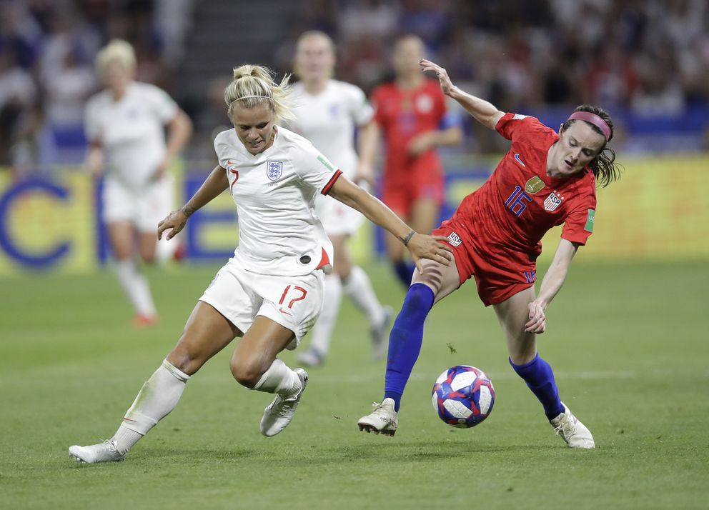 England's Rachel Daly, left, challenges for the ball with United States' Rose Lavelle during the Women's World Cup semifinal soccer match between England and the United States, at the Stade de Lyon, outside Lyon, France, Tuesday, July 2, 2019. (AP Photo/Alessandra Tarantino)