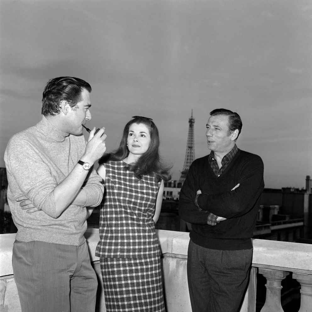 French actor Yves Montand (right) meets US actress Jessica Walter (center) before the filming of 'Grand Prix ' directed by John Frankenheimer (left) at the terrace of an hotel in Paris on April 9, 1966. (AFP via Getty Images/TNS)