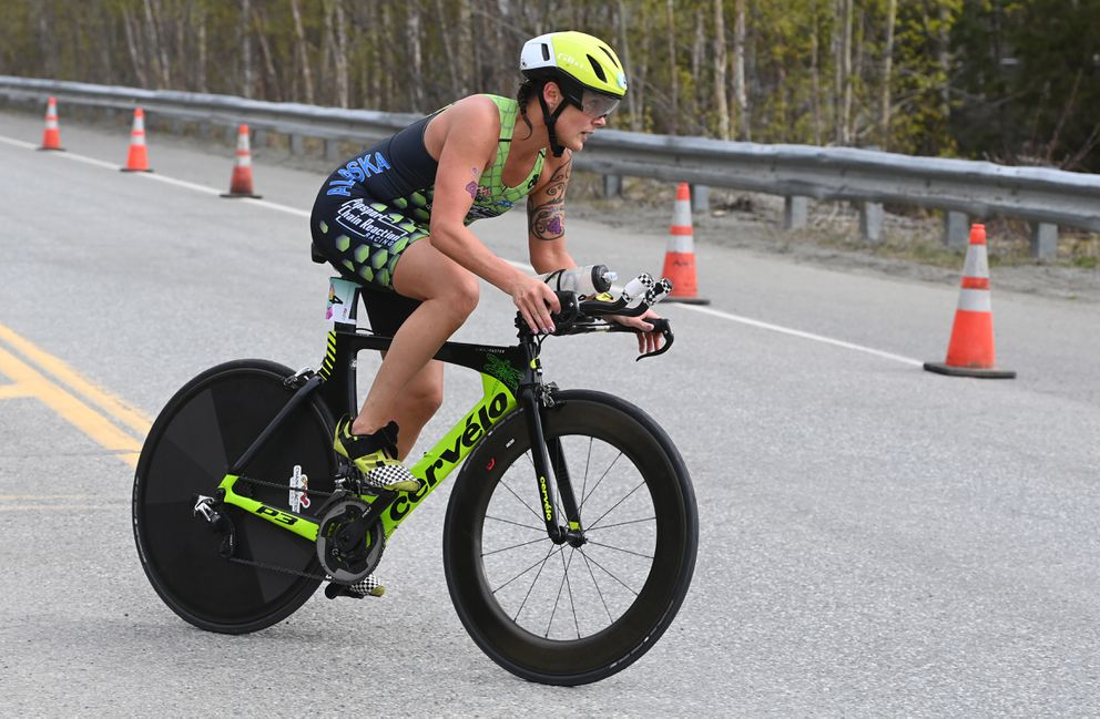 Amber Stull nears the end of the bike course during the Gold Nugget Triathlon at Chugiak High School on Sunday, May 16, 2021. (Bill Roth / ADN)