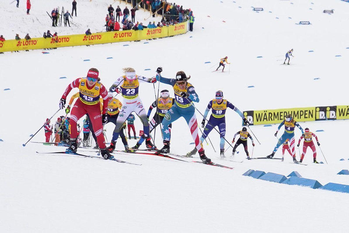 Rosie Brennan of Anchorage (bib 13) crests a hill in a World Cup skiathlon in Oberstdorf, Germany. She placed 17th in the race to lead the U.S. Ski Team. (Sarah Brunson / US Ski Team)