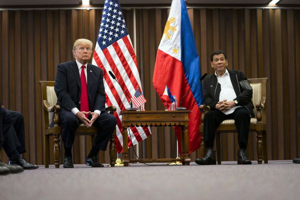 """FILE -- President Donald Trump with President Rodrigo Duterte of the Philippines at the 31st Association of Southeast Asian Nations summit meeting in Manila on Nov. 13, 2017. Duterte has blamed """"fake news"""" for coverage of his war on drug traffickers, which has killed thousands of Filipinos, many without trial. (Doug Mills/The New York Times)"""