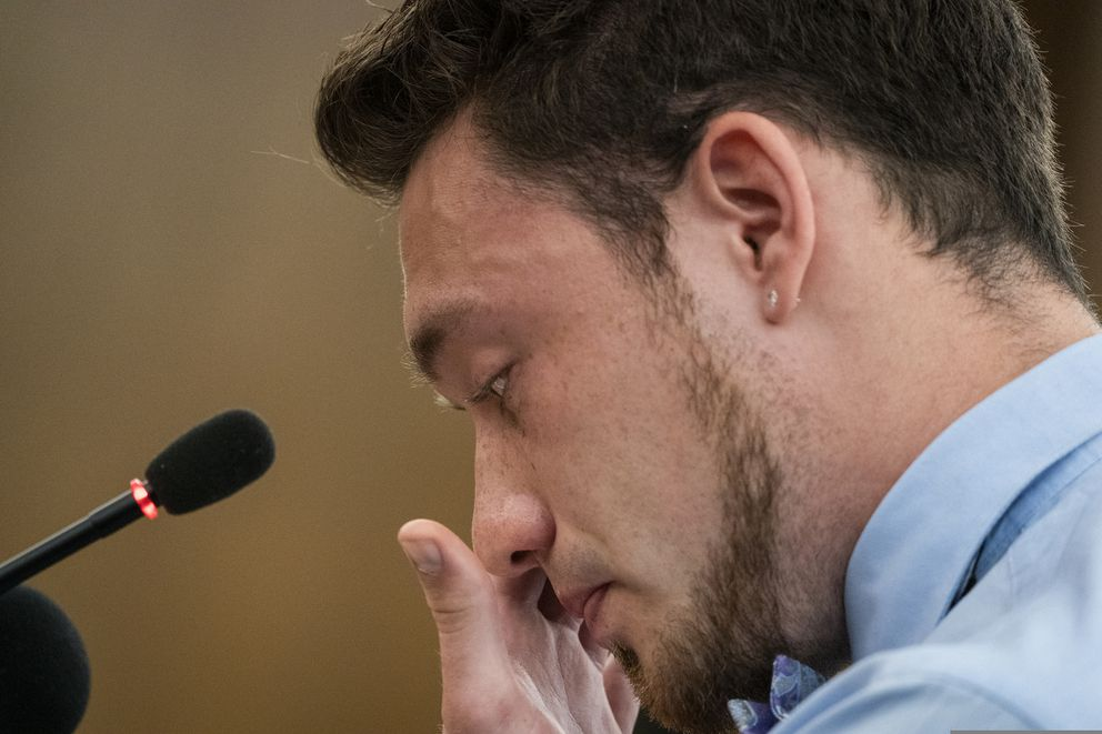 Zach Damond, the son of Justine Ruszczyk Damond's fiance Don Damond, gets emotional while reading his victim impact statement, at the Hennepin County District Court in Minneapolis Friday, June 7, 2019, before the sentencing of former Minneapolis police officer Mohamed Noor in the fatal shooting of Justine Ruszczyk Damond. (Leila Navidi/Star Tribune via AP, Pool)