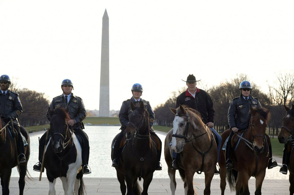 New Interior Secretary Ryan Zinke (2nd from right) rides on horseback with a U.S. Park Police horse mounted unit while reporting for his first day of work at the Interior Department in Washington, U.S., March 2, 2017. Tami Heilemann/Department of Interior/Handout via REUTERS