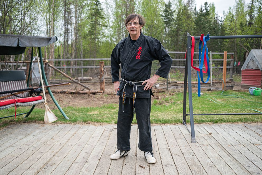 Karate instructor Michael Taylor poses for a photo at his home on Thursday, May 22, 2020 in Wasilla. Taylor has been out of work since his dojo closed on March 13. (Loren Holmes / ADN)