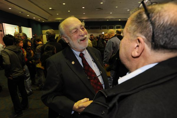 Rep. Bob Lynn of Anchorage and Sen. Lyman Hoffman of Bethel shake hands at Election Central in the Egan Center in Anchorage after the polls closed on Tuesday, Nov. 4, 2014. Both candidates were winning bibs for re-election.