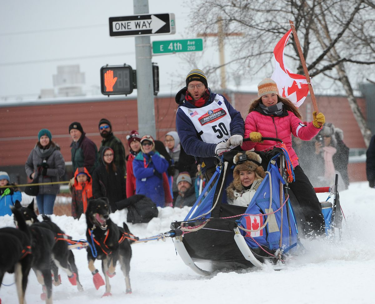 Aaron Peck and his Iditarider round the corner at Fourth Avenue and Cordova Street at the start of the 2018 Iditarod. (Bob Hallinen / ADN archive)
