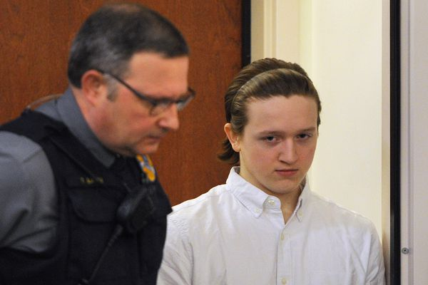 Erick Almandinger, right, enters the courtroom after a break during the opening statements in his murder trial at the Palmer courthouse on Monday, May 14, 2018. Almandinger is the first of four teenagers who have been charged with the November 2016 murder of 16-year-old David Grunwald to go to trial. (Bill Roth / ADN)