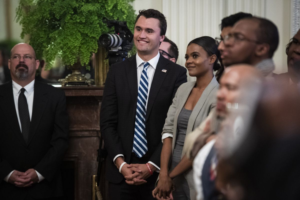Charlie Kirk, center, and Candace Owens of Turning Point USA, listen to President Donald Trump speak in 2018. MUST CREDIT: Washington Post phooto by Jabin Botsford