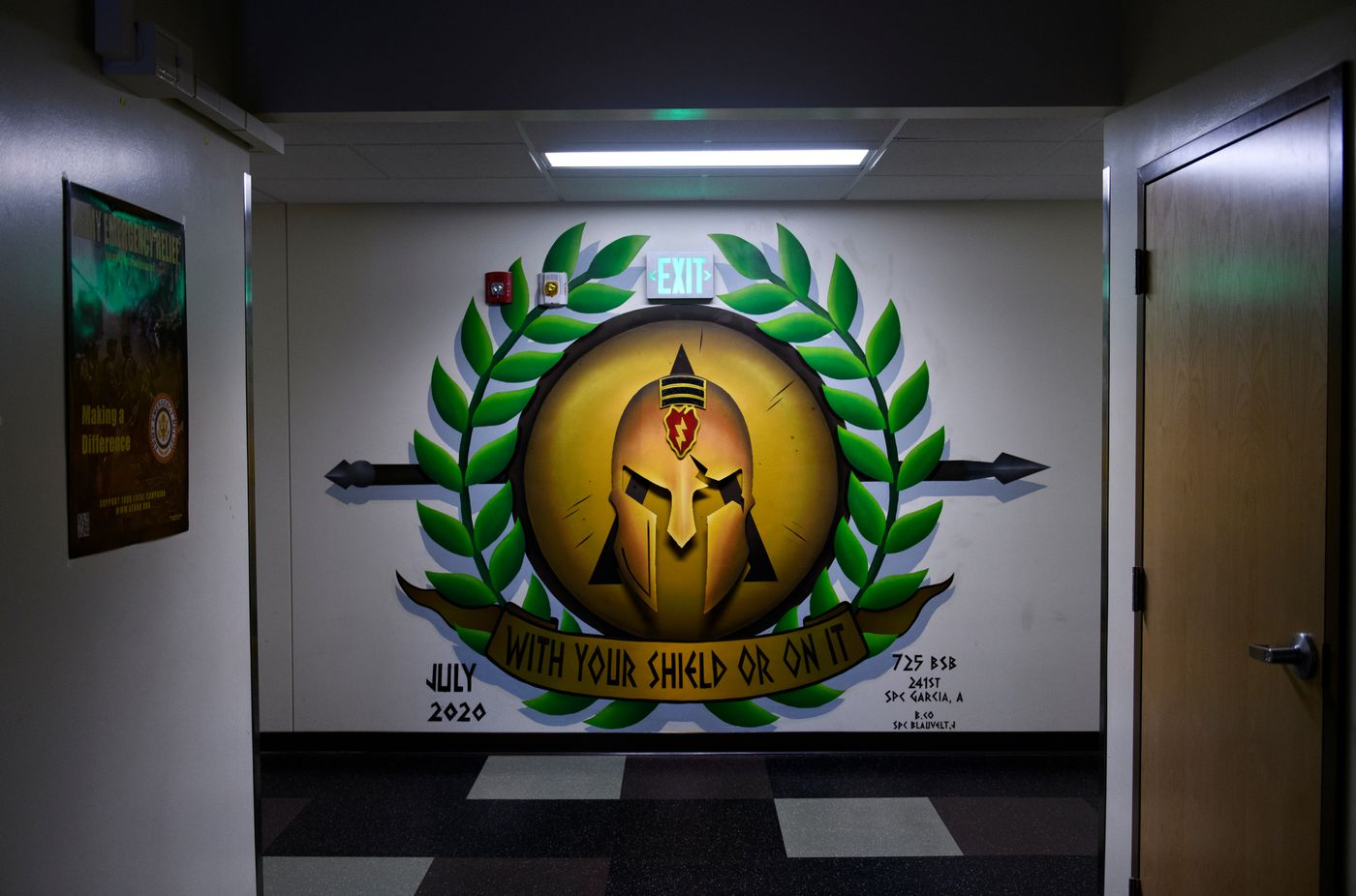 A mural Spc. Andrew Garcia created for the headquarters of the 4th Brigade Combat Team (Airborne), 25th Infantry Division, includes a metal Spartan helmet protruding from the wall. (Marc Lester / ADN)