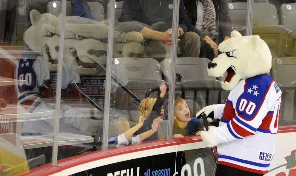 Boomer the Alaska Aces mascot interacts with young fans before the start of the hockey game against the Indy Fuel at Sullivan Arenain 2016. (Bob Hallinen / ADN archive 2016)