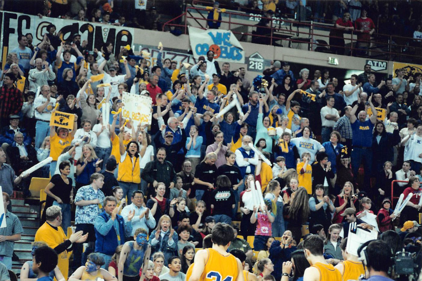 Kodiak High School boys basketball fans cheer for their team in the Sullivan Arena on March 24, 2001. (Photo courtesy Amy Fogle)