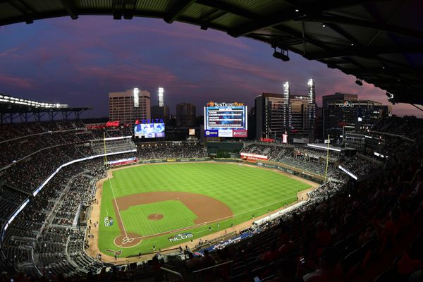 FILE - In this Oct. 7, 2018, file photo, ground crews prepare the field at Sun Trust Park, now known as Truist Park, ahead of Game 3 of MLB baseball's National League Division Series between the Atlanta Braves and the Los Angeles Dodgers in Atlanta. Truist Park lost the 2021 All-Star Game on Friday, April 2, 2021, when Major League Baseball decided to move the game elsewhere over the league's objection to Georgia's sweeping new election law that critics say restricts voting rights. (AP Photo/John Amis, File)