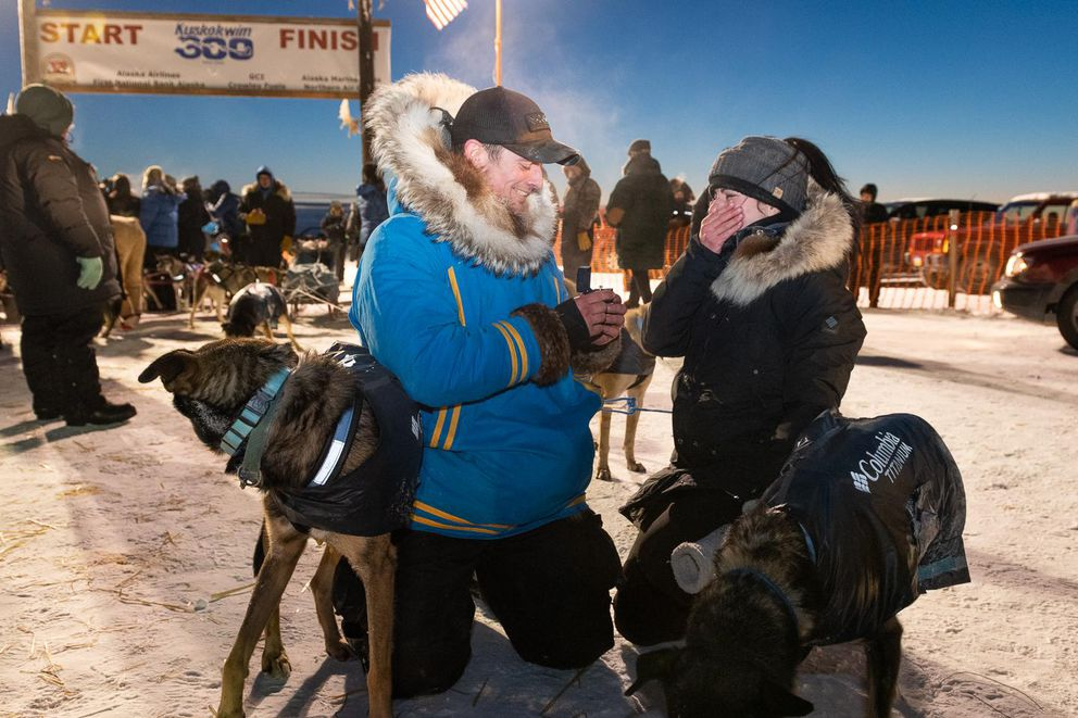 Musher Matthew Failor proposes to his girlfriend, Liz Raines, after finishing the Kuskokwim 300 in second place on January 19, 2020 in Bethel, Alaska. She said yes! (Katie Basile / KYUK Public Media)
