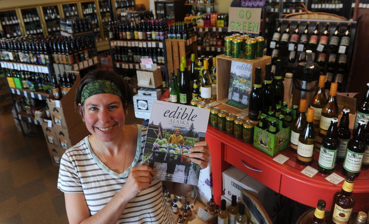 Mary Smith holds the new local food quarterly magazine Edible Alaska at the La Bodega liquor store inAnchorage. Smith, editor of the magazine, wasdistributingcopies to retailoutlets. (Bob Hallinen / Alaska Dispatch News)