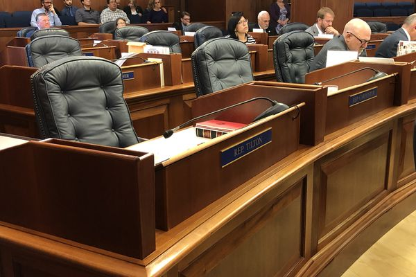Rows of legislative seats sit vacant on Monday, July 8, 2019 as the Alaska Legislature convenes the second special session of 2019. (James Brooks / ADN)