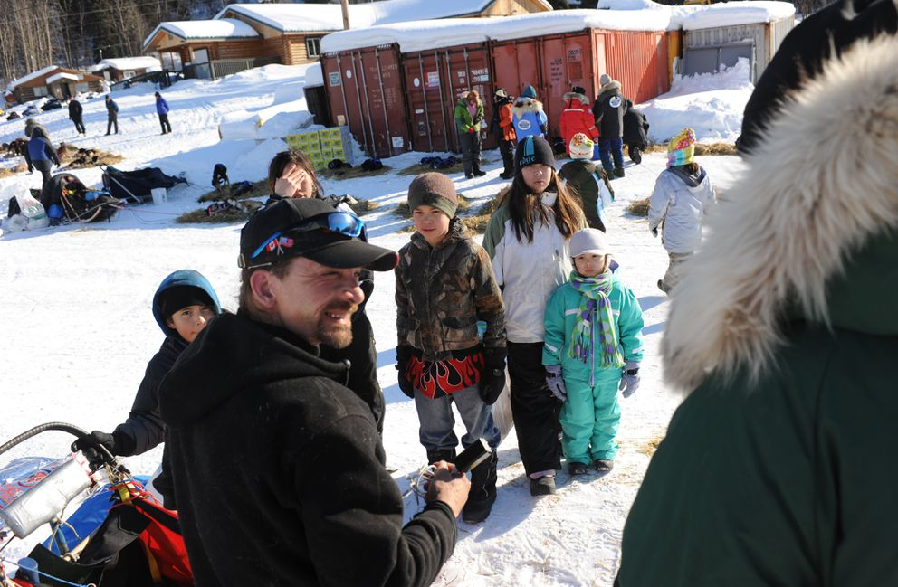 Iditarod musher Lance Mackey talks with head Iditarod vet Stu Nelson in the Yukon River village of Anvik during the 2011 Iditarod Trail Sled Dog Race March 11, 2011. (BOB HALLINEN / ADN archive 2011)