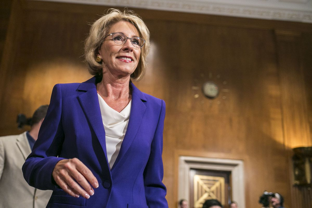 "Betsy DeVos, Donald Trump's nominee for education secretary, arrives at her confirmation hearing before the Senate Health, Education, Labor and Pensions Committee on Capitol Hill, in Washington, Jan. 17. DeVos defended her work steering taxpayer dollars from traditional public schools at her hearing on arguing that it was time to move away from a ""one size fits all"" system. (Al Drago / The New York Times)"