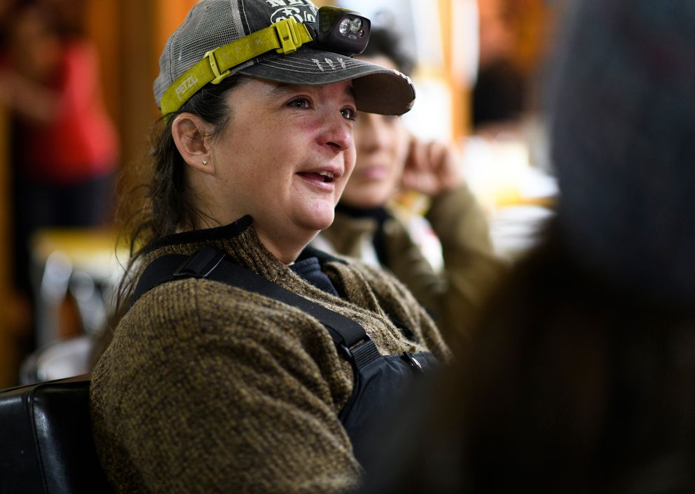 Jessie Royer talks with other mushers inside the Takotna community hall on March 6, 2019, during the 2019 Iditarod. (Marc Lester / ADN)