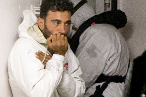 Tunisian navigator Mohammed Ali Malek, one of the survivors of the boat that overturned off the coast of Libya, waits to disembark from Italian Coast Guard ship Bruno Gregoretti, at Catania Harbor, Italy, on Monday.