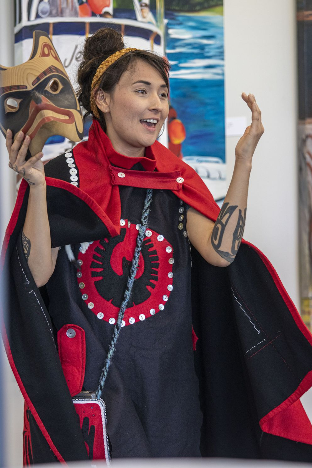Alumni and Native Dancers mingle during the first Alumni Mixer in the Leah J Peterson gallery on the campus of APU. (Ted Kincaid/Alaska Pacific University)