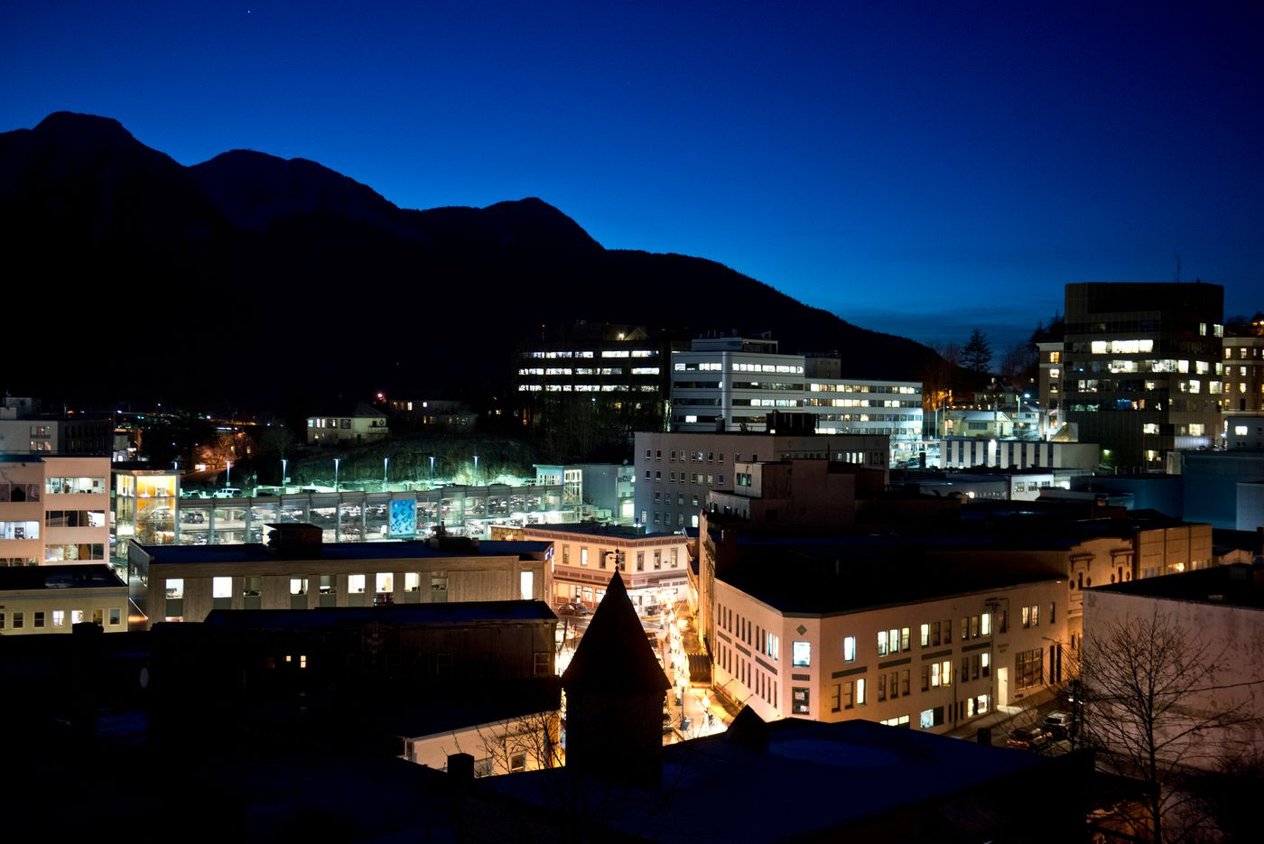 The lights of downtown Juneau glow after sunset on Jan. 20.