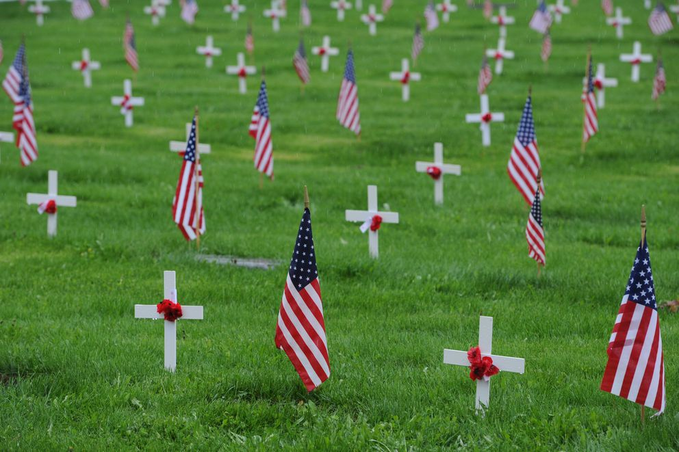 American Legion Jack Herny Post 1 placed white crosses with a poppies and the Veterans of Foreign Wars Captain James G. Lee Memorial Post 1685 placed American flags at the graves of veterans buried at the Anchorage Memorial Park Cemetery on Sunday, May 26, 2019. . (Bill Roth / ADN)